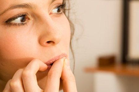 Woman biting nails, close-up, selective focus, canon 1Ds mark III